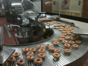 Doughnuts on a conveyer belt
