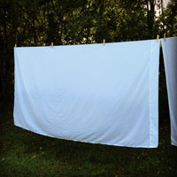 White sheets on a clothesline