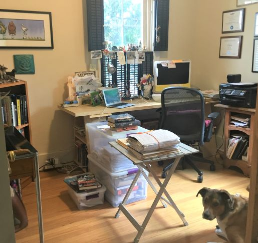 Candace Fleming's home study with her dog.