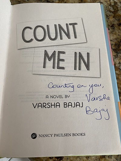 The title page of the novel Count Me In, signed by the author, Varsha Bajaj
