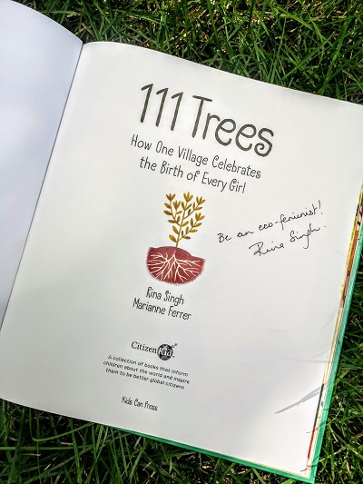 "The title page from 111 Trees, written by Rina Singh, illustrated by Marianne Ferrer, signed by Rina Singh with the message, ""Be an eco-feminist!"""