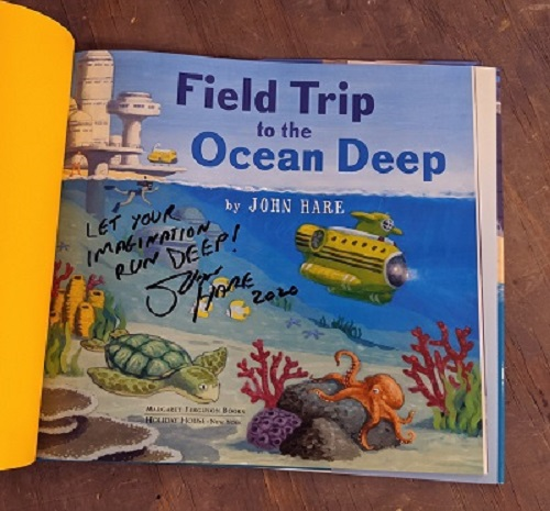 "A picture of the title page from Field Trip to the Ocean Deep, signed by the author and illustrator John Hare with the message, ""Let your imagination run deep!"""