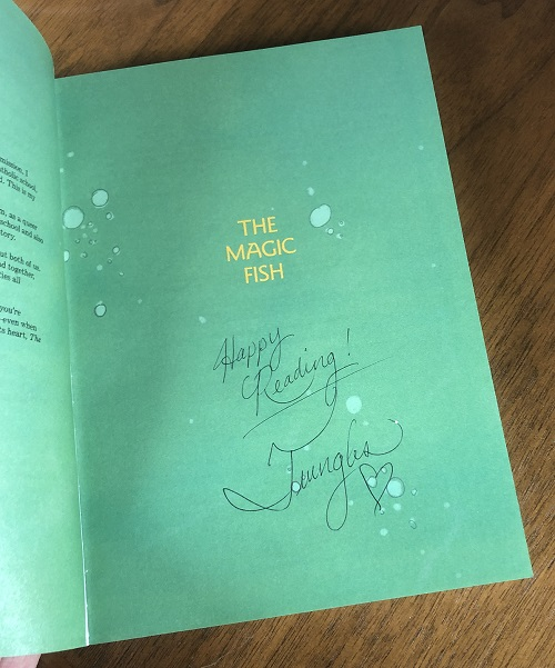 The title page of the graphic novel The Magic Fish, signed by the author Trung Le Nguyen.