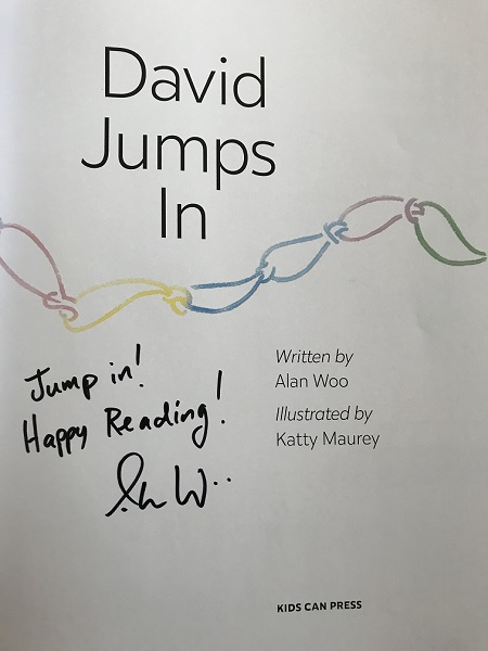 "The title page of David Jumps In, signed by the author, Alan Woo, with the message, ""Jump In! Happy Reading!"""