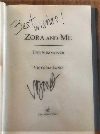 The title page of Zora and Me: The Summoner, signed by the author, Victoria Bond.