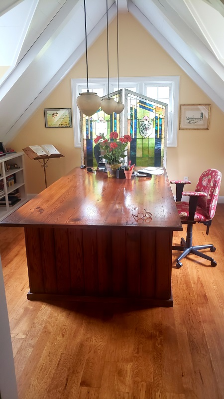 Author Kate Klise's study with her large wooden desk.