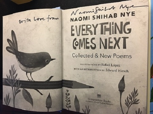 """The title page of Everything Comes Next: Collected and New Poems, signed by the author with the message, """"With love from Naomi Shihab Nye."""""""