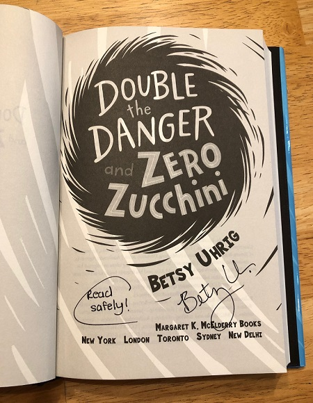 The title page of the novel Double the Danger and Zero Zucchini signed by the author Betsy Uhrig.