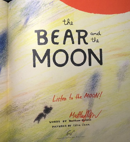 "The title page of The Bear and the Moon, signed by the author, Matthew Burgess, with the message, ""Listen to the Moon."""