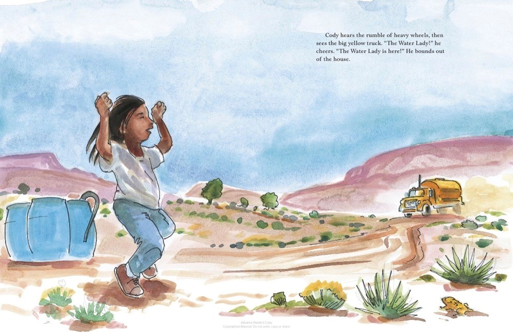 An interior image from The Water Lady, by Alice McGinty and Shanto Begay, showing a Navajo boy standing in his desert landscape and cheering when he sees a schoolbus carrying water to his home.