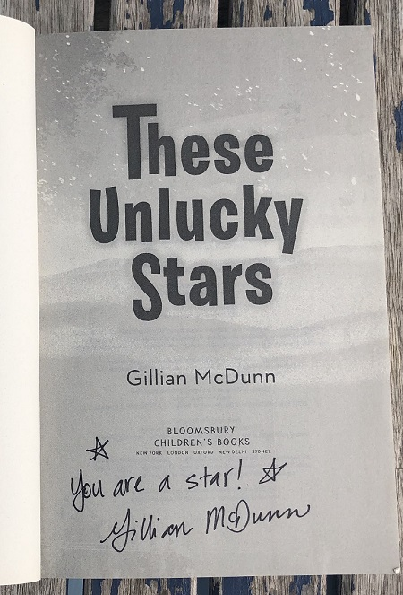 """The title page of These Unlucky Stars, signed by the author, Gillian McDunn, with the message """"You are a star!"""""""