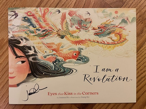 The title page of Eyes That Kiss in the Corners, signed by the author, Joanna Ho.