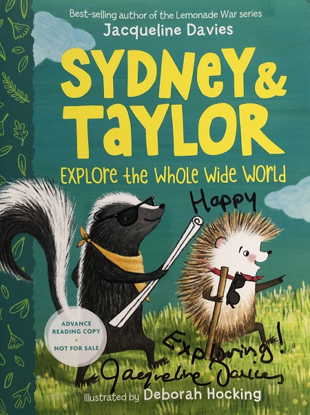"""The cover of an advanced reader copy of Sydney and Taylor Explore the Whole Wide World, signed by the author, Jacqueline Davies, with the message, """"Keep Exploring!"""""""