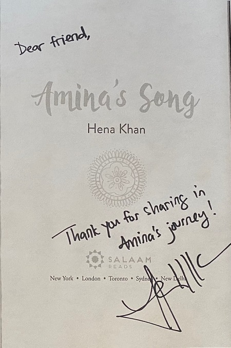 "The title page of Amina's Song, signed by the author, Hena Khan, with the message, ""Thank you for sharing in Amina's journey!"""