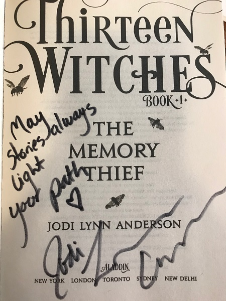 "The title page of The Memory Thief, signed by the author, Jodi Lynn Anderson, with the message, ""May stories always light your path."""