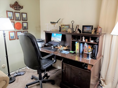 Author Lisa Fipps' writing desk, surrounded by meaningful objects.