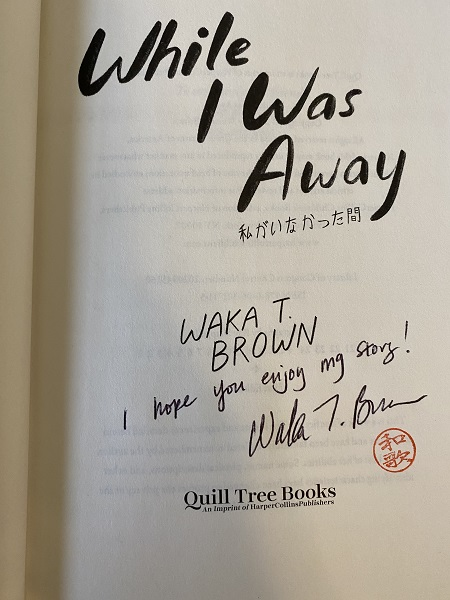 "The title page of While I Was Away, signed by the author, Waka T. Brown, with the message, "" I hope you enjoy my story!"""