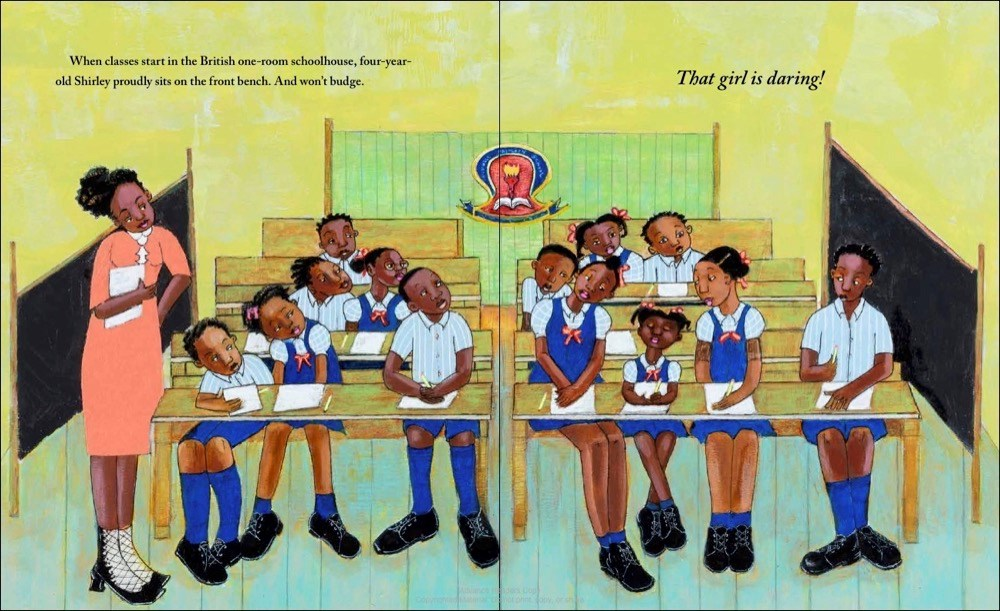 An interior image from Shirley Chisholm Dared, written by Alicia D. Williams and illustrated by April Harrison, showing Shirley Chisholm as a schoolgirl in Barbados in a colonial British classroom, insisting on sitting in the front bench with the older children.