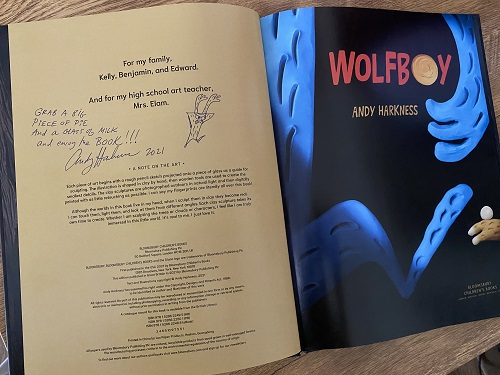 """The copyright page of Wolfboy, signed by the author and illustrator, Andy Harkness, with the message, """"Grab a big piece of pie and a glass of milk and enjoy the book!"""""""