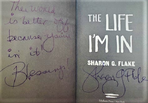 """A title page from The Life I'm In, signed by the author, Sharon Flake, with the message, """"The world is better because you're in it! Blessings!"""""""