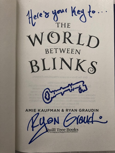 """The title page of The World Between Blinks, signed by the co-author,Ryan Graudin, with the message, """"Here's your key to..."""" The author also drew a picture of a key."""