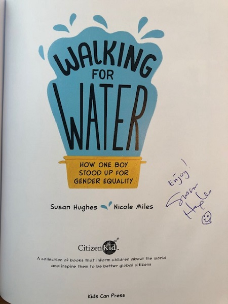 """The title page of Walking for Water signed by the author, Susan Hughes, with the message, """"Enjoy!"""""""