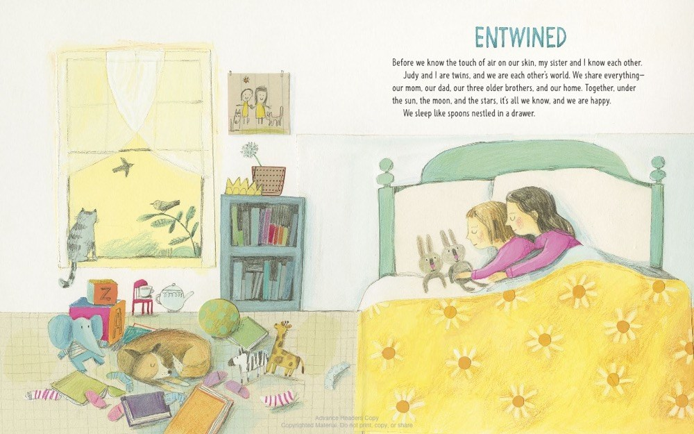 An interior image from Unbound: The Life and Art of Judith Scott showing Judith and Joyce Scott as children, snuggled and sleeping in a sunny bedroom.