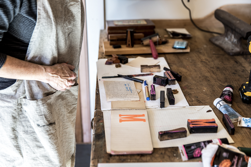 An interior image of Melissa Sweet's studio showing a worktable with ink stamps.