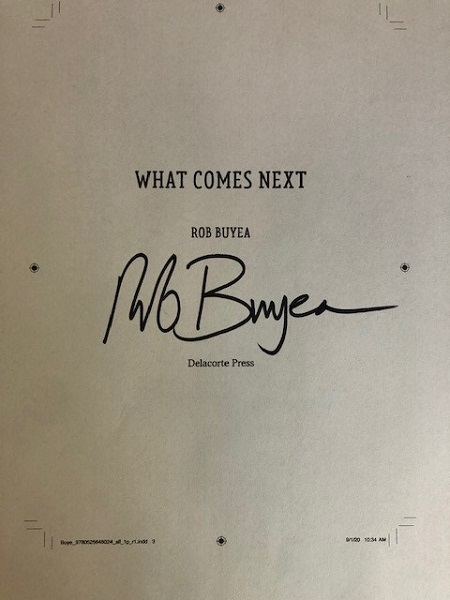 The title page of What Comes Next, signed by the author, Rob Buyea.