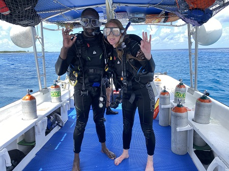 Miranda Paul in scuba diving gear with her husband and frequent collaborator, Baptiste Paul.