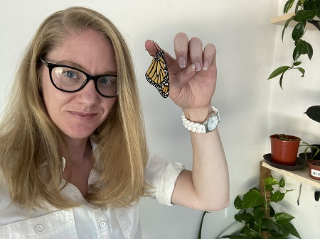 Miranda Paul with a monarch butterfly that she has raised.