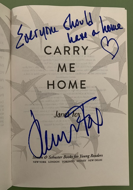 """The title page of Carry Me Home, signed by the author, Janet Fox, with the message, """"Everyone should have a house."""""""