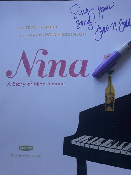 """The title page of Nina: A Story of Nina Simone, signed by the author, Traci N. Todd, with the message, """"Sing Your Song!"""""""